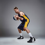 Full length portrait of a basketball player posing with ball Stock Image