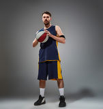 Full length portrait of a basketball player posing with ball Stock Photography