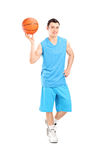 Full length portrait of a basketball player posing with a ball Stock Images