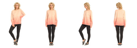 Full length portrait of beautiful blonde in coral pullover Royalty Free Stock Photography