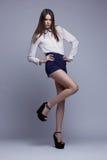 Full-length portrait of beautiful brunette woman. Fashion shot Royalty Free Stock Photography