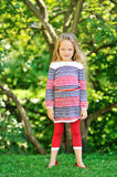 Full length portrait of a beautiful little girl posing outdoors Stock Photography