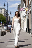 Full length portrait of beautiful model woman walking in white Royalty Free Stock Photos
