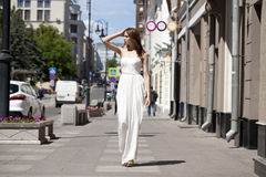Full length portrait of beautiful model woman walking in white Stock Images