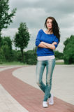 Full length portrait of a beautiful naughty brunette woman in jeans. Full length street portrait of a beautiful naughty brunette woman in jeans Royalty Free Stock Images