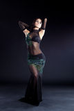 Beautiful oriental dancer in black dress Stock Image