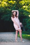 Full length portrait of a beautiful plus size fashion model in pink dress, young woman outdoors Stock Photo