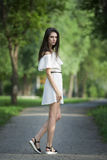 Full length portrait of a beautiful young caucasian woman in white dress with open shoulders, clean skin, long hair and casual mak Royalty Free Stock Photos