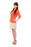 Full-length portrait of a beautiful young girl in an orange dres Royalty Free Stock Image