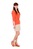 Full-length portrait of a beautiful young girl in an orange dres Stock Photo