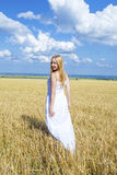Full-length portrait of a beautiful young girl in a white dress Stock Images