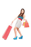 Full length portrait of a beautiful young woman with shopping ba Royalty Free Stock Images