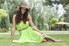 Full length portrait of beautiful young woman in sundress at park Royalty Free Stock Image