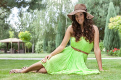 Full length portrait of beautiful young woman in sundress at park royalty free stock photography