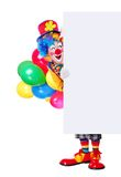 Full length portrait of a birthday clown holding the blank board Stock Image
