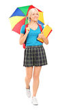 Full length portrait of a blond female student walking Stock Photos