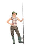 Full length portrait of a blond fisherwoman posing Royalty Free Stock Images