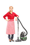 Full length portrait of a blond housewife posing on a vacuum cle Royalty Free Stock Images