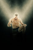 Full length portrait of boxer fighter in kick motion Royalty Free Stock Photography