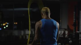 Full length portrait of a boxer jumping with skipping rope. Athletic, muscular young boxer shirtless with jumping rope stock video footage