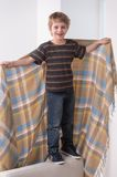 Full length portrait of boy with blanket. Stock Photography