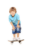 Full length portrait of a boy riding a skateboar Royalty Free Stock Photography