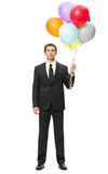 Full-length portrait of business man with balloons. Isolated on white. Concept of leadership and success Royalty Free Stock Photography