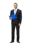 Full-length portrait of business man with documents Royalty Free Stock Images