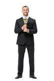 Full-length portrait of business man with golden cup Stock Photography