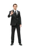 Full-length portrait of business man ok gesturing Stock Image