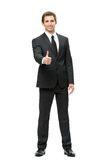 Full-length portrait of business man thumbing up Royalty Free Stock Images