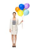Full length portrait of business woman with balloons Stock Photography