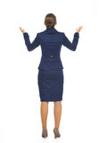 Full length portrait of business woman begging Royalty Free Stock Image