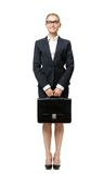 Full-length portrait of business woman with black case. Full-length portrait of business woman handing suitcase, isolated on white. Concept of leadership and Stock Photos