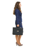 Full length portrait of business woman with briefcase Royalty Free Stock Photos