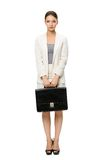 Full-length portrait of business woman with case. Isolated on white. Concept of leadership and success Stock Images