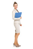 Full length portrait of business woman with folder Stock Photography
