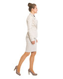Full length portrait of business woman going sideways Stock Images