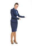 Full length portrait of business woman inviting. Full length portrait of happy business woman inviting royalty free stock photo