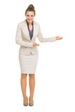 Full length portrait of business woman inviting Stock Photo
