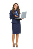 Full length portrait of business woman with laptop Stock Photo