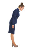 Full length portrait of business woman making asian greeting. High-resolution photo Stock Images