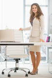 Full length portrait of business woman  in office Royalty Free Stock Photos
