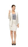 Full-length portrait of business woman ok gesturing Royalty Free Stock Images
