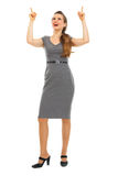 Full length portrait of business woman pointing up Royalty Free Stock Photo