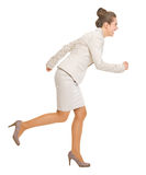 Full length portrait of business woman running sideways Royalty Free Stock Photo