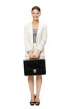 Full-length portrait of business woman with suitcase. Isolated on white. Concept of leadership and success Royalty Free Stock Images