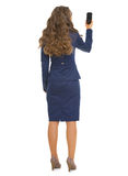 Full length portrait of business woman taking photo with phone. Full length portrait of business woman taking photo with cell phone . rear view Royalty Free Stock Images