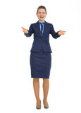 Full length portrait of business woman welcoming. Full length portrait of smiling business woman welcoming Royalty Free Stock Photography