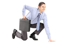 Full length portrait of a businessman with briefcase getting rea Royalty Free Stock Photo